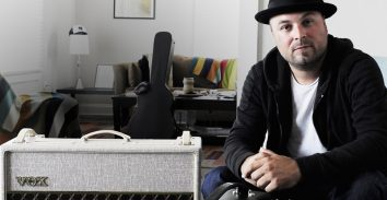 artist, Guthrie Trapp, sitting in appartment beside VOX amplifier