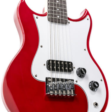 closeup of body of red VOX mini electric guitar