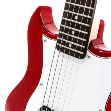 closeup of red VOX mini electric guitar
