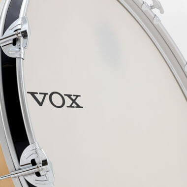 closeup of VOX logo on drum set