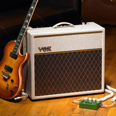 electric guitar leaning against VOX amplifier