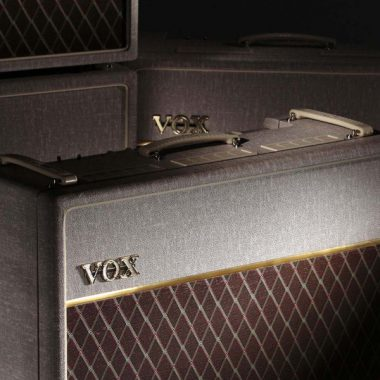 closeup of VOX amplifier with VOX amplifiers in the background