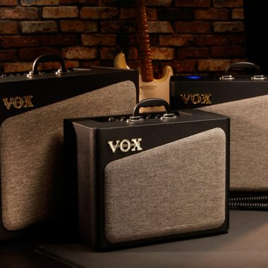 three brown and black VOX amplifiers