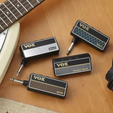 four VOX AmPlugs between VOX electric guitar and headphones