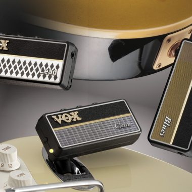 three VOX AmPlugs plugged in to electric guitars