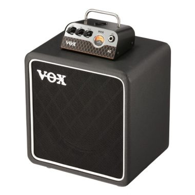 VOC AC tube head on top of VOX guitar amplifier