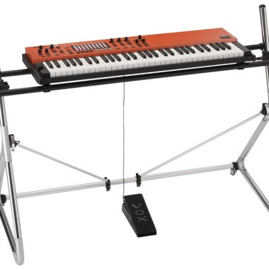 orange VOX keyboard on stand