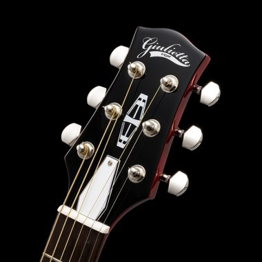 closeup of headstock on VOX electric guitar